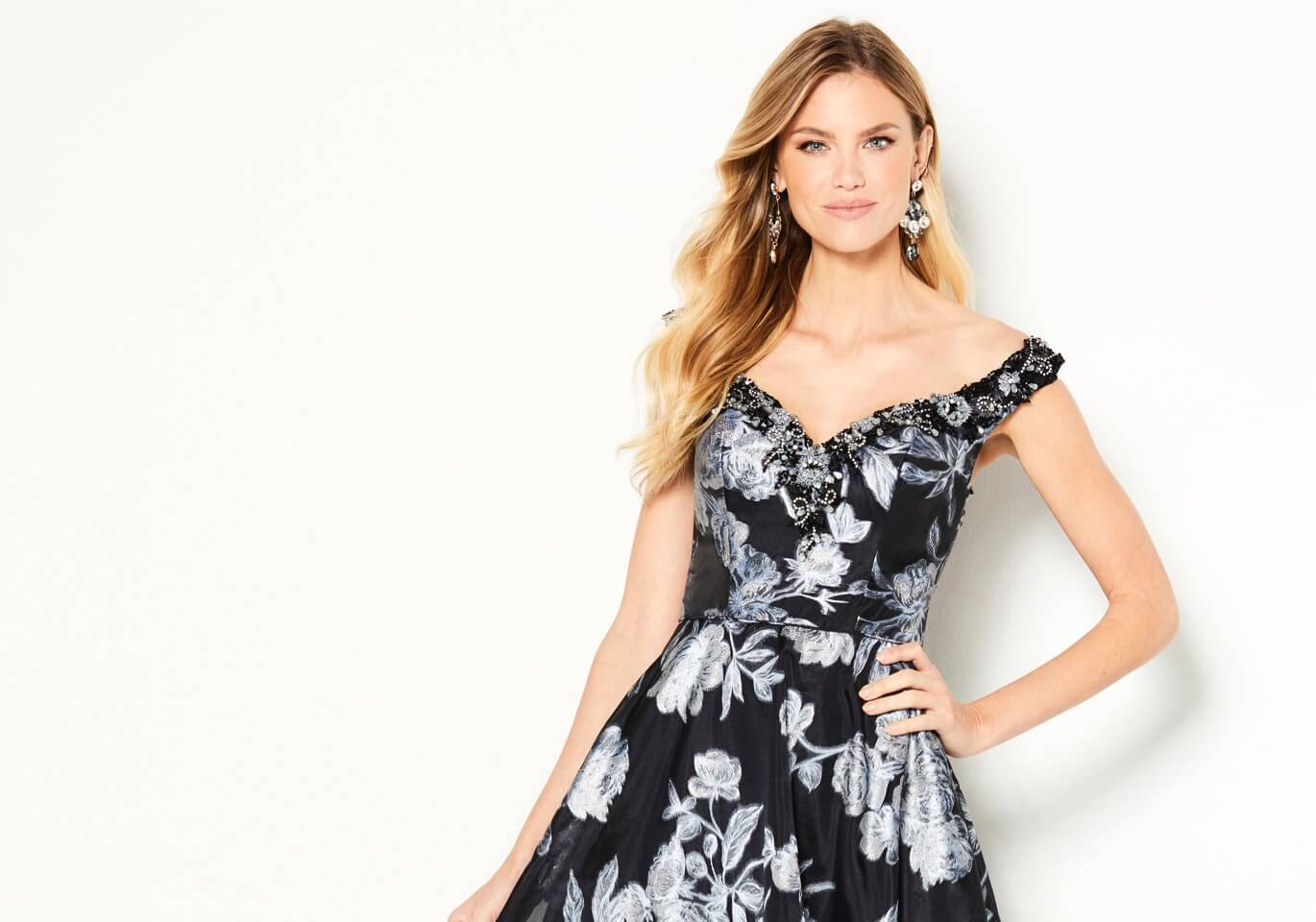 Model wearing a black floral dress